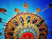 stock photo of swing  - Instagram filtered image of an amusement park swing ride - JPG