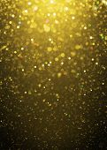 Defocused gold sparkle glitter lights background. Highlighted glitter bokeh background