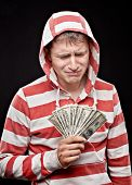 Crying Young Man With  Money