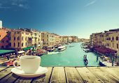 stock photo of gondola  - coffee on table and Venice in sunset time - JPG