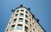 MOSCOW - JUNE 25, 2014: Industrial mountaineering workers wash windows of a high-rise building