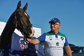 TSELEEVO, MOSCOW REGION, RUSSIA - JULY 26, 2014: Alexis Rodzianko holds the best polo pony during th