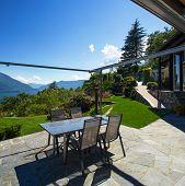 Veranda with panoramic view in the garden