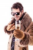 pic of hustler  - a young man wearing a sheepskin coat isolated over a white background holding a cigar and a glass with champagne - JPG