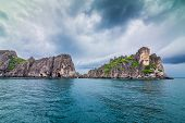 foto of sky diving  - Tropical rock islands for diving against blue sky Southern of Thailand