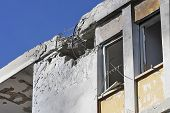ASHKELON, ISRAEL - JANUARY 10, 2009: Hole in the roof,  broken windows and damaged apartment after d