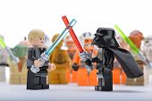 Ankara, Turkey - April 06, 2013: Lego Star Wars Darth Vader and Luke Skywalker are fighting with sword in front of Star Wars minifigures