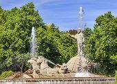 picture of chariot  - Neptune with Trident Snake in Chariot Roman God Statue Fountain Fuento de Neptuno Plaza Canovas del Castillo Madrid Spain - JPG