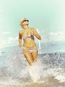 Beauty Woman Running On The Beach