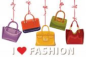 Colorful fashion women's handbags hang on ribbons