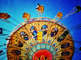 image of carnival ride  - Instagram filtered image of an amusement park swing ride - JPG