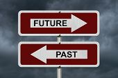 image of past future  - Future versus Past Red and white street signs with words Future and Past with stormy sky background - JPG