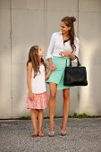 Mother And Daughter In City
