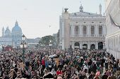 Crowd Of Tourist In St. Mark Square During The Carnival Of Venice