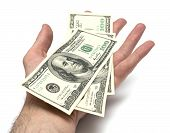 Isolated Hand With Pack Of One Hundred Dollars