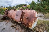 image of junk-yard  - rusty cistern on junk yard near Illinci village in Chernobyl Nuclear Power Plant Zone of Alienation Ukraine - JPG