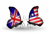 Two Butterflies With Flags On Wings As Symbol Of Relations Uk And Liberia