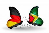 Two Butterflies With Flags On Wings As Symbol Of Relations Germany And Guyana