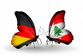 Two butterflies with flags on wings as symbol of relations Germany and Lebanon