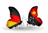 image of papua new guinea  - Two butterflies with flags on wings as symbol of relations Germany and Papua New Guinea - JPG
