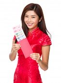 Woman hold with red lucky money with RMB