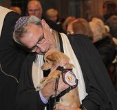 Rabbi Rubinstein with rescue dog