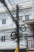 Phuket City, TH-Sept,18 2014:A pillar with lots of wires on the street in Thailand, Phuket Town