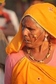 Senior Indian Woman With Yellow Veil