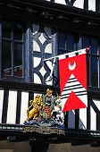 Medieval flag on Tudor building.