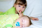 The girl has put the kid to sleep