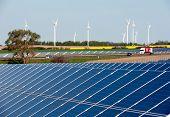 Rape field, solar modules, wind turbines