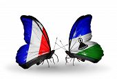 Two Butterflies With Flags On Wings As Symbol Of Relations France And Lesotho