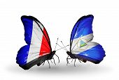 Two Butterflies With Flags On Wings As Symbol Of Relations France And Nicaragua