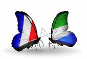 Two Butterflies With Flags On Wings As Symbol Of Relations France And Sierra Leone