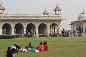 Indian People Relaxing On The Grass