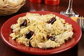 stock photo of kalamata olives  - Chunks of chicken breast with orzo Kalamata olives and spinach - JPG