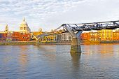 St. Paul's cathedral with the Millennium bridge in London UK