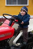 Baby On Tractor Old