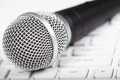 stock photo of singing  - Microphone on the keyboard. Music and singing ** Note: Shallow depth of field - JPG