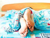 Sleeping woman's cute feet