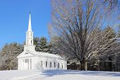 pic of mary  - A white New England Chapel on a winter day.