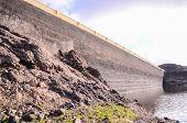 stock photo of dam  - Artificial Lake Water Dam in the Canary Islands Gran Canaria - JPG