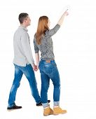 stock photo of she-male  - Back view of walking young couple  - JPG