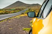 foto of paysage  - Yellow car on a background of mountains - JPG