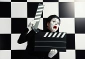 picture of clapper board  - Movie actor and a mime posing with clapper board with different emotions - JPG