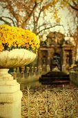 stock photo of garden sculpture  - Stone vase with flowers at Medici Fountain in the Luxembourg Garden - JPG