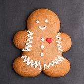 picture of gingerbread man  - Decorated gingerbread man cookie against black background - JPG