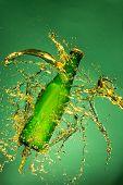picture of freezing  - Green beer bottle with splashing liquid - JPG