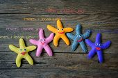 stock photo of mother-in-love  - Happy mothers day with i love you mom message idea from colorful fabric starfish on wooden background abstract wooden texture mother - JPG