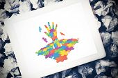 pic of autism  - Autism awareness hand against tablet pc - JPG